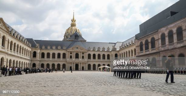 French Republican Guards carry the coffin of French filmmaker and writer Claude Lanzmann during a tribute ceremony at the Invalides in Paris on July...
