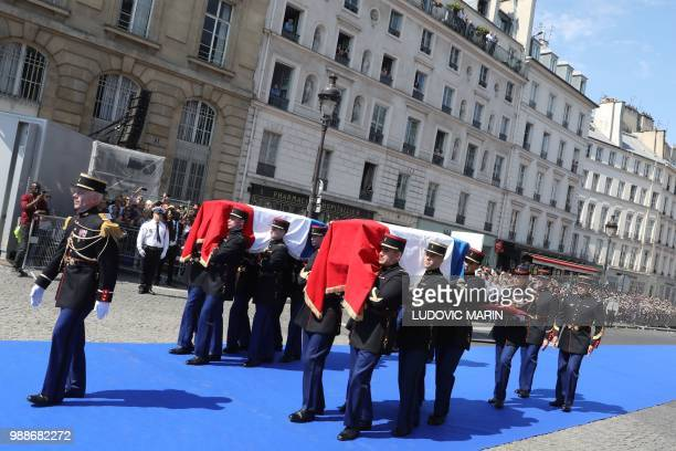 French Republican Guards carry the coffins of former French politician and Holocaust survivor Simone Veil and her husband Antoine Veil as they walk...