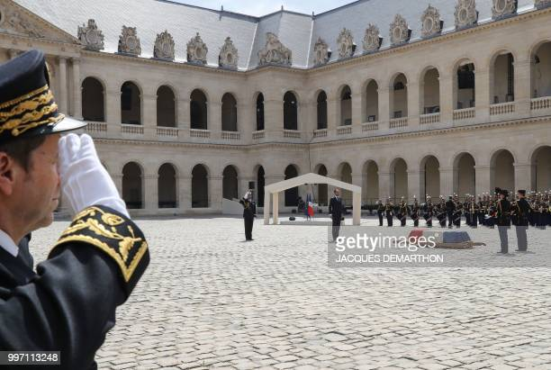 French Republican Guards stand on duty as French Prime minister Edouard Philippe takes part in a tribute ceremony to French filmmaker and writer...