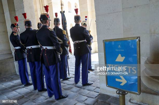 French Republican Guards stand on duty during a tribute ceremony to French filmmaker and writer Claude Lanzmann at the Invalides in Paris on July 12...