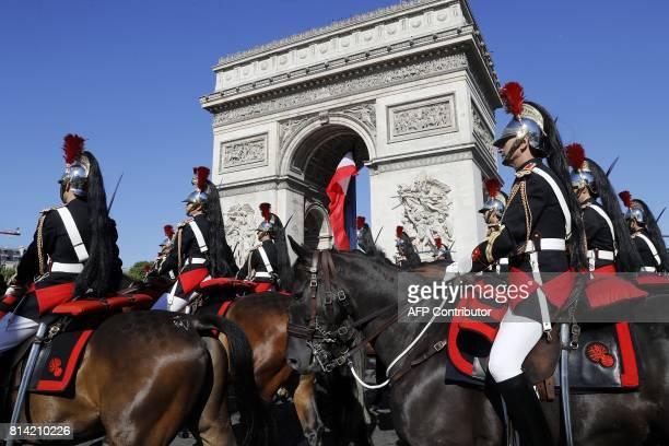 French Republican guards take part in the annual Bastille Day military parade on the ChampsElysees avenue in Paris on July 14 2017 The parade on...
