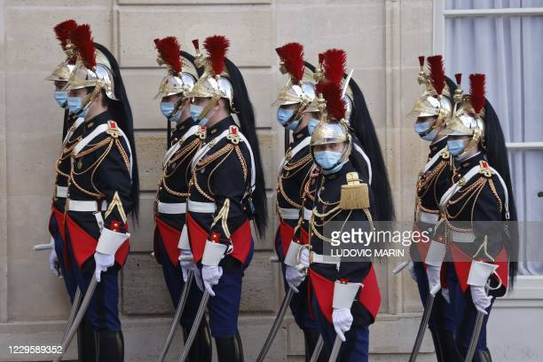 French Republican Guards, wearing face masks, wait for the arrival of Senegalese President at the Elysee Palace in Paris on November 12, 2020.