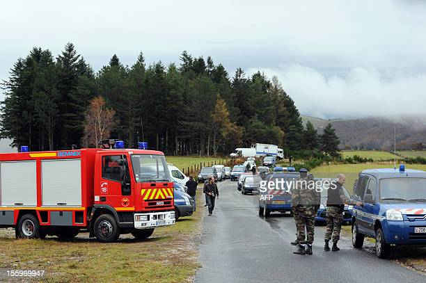 French rescue team work on November 10 2012 near the scene of the accident where an Algerian military cargo plane travelling with six people on board...