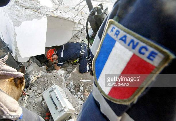 French rescue workers search for survivors in a collapsed school building in Balakot North West Frontier Province 10 October 2005 Between 30 000 and...
