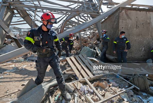 French rescue workers search through the rubble in the devastated Beirut port on August 7 three days after a massive blast there shook the Lebanese...