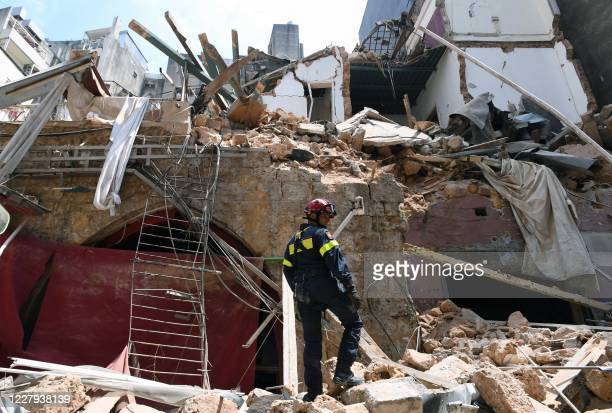 French rescuer stands amidst the rubble of a building in the Gemayzeh neighbourhood on August 6 two days after a massive explosion in the Beirut port...