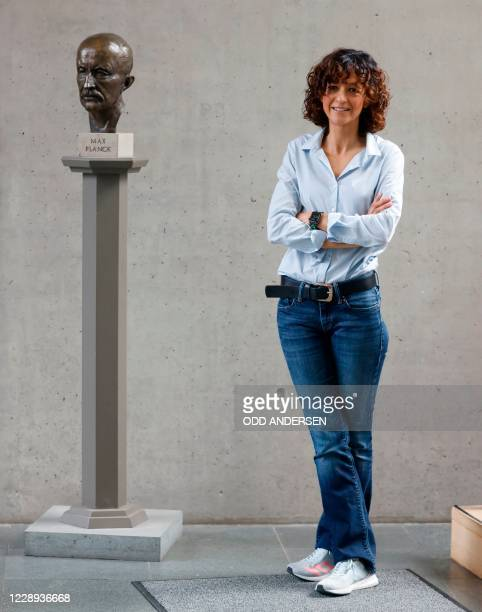 French researcher in Microbiology, Genetics and Biochemistry Emmanuelle Charpentier poses for photographers next to a bust of Max Planck in Berlin,...