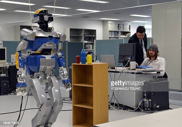 French researchers display a demonstration of a humanoid robot HRP2 which is controlled by human brain activity with the brain machine interface in...
