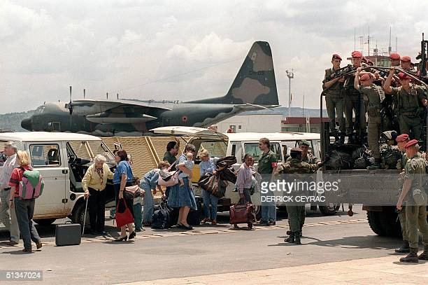 French residents from France the United States Belgium and Japan step out of vans to proceed towards liners ready to evacuate them 06 October 1990 at...