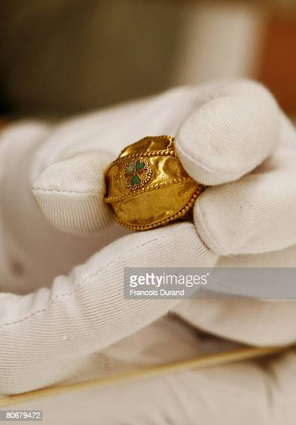 French restorers examine gold necklace pieces from the first century discovered in 1978 on the archeological site of Tillia Tepe and exhibited for...