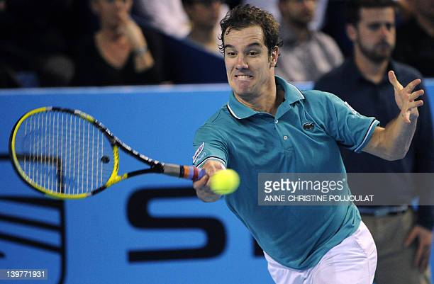 French Richard Gasquet hits a return to Argentinian Juan Martin Del Potro during the ATP Open 13 tennis tournament final quarter on February 24, 2012...