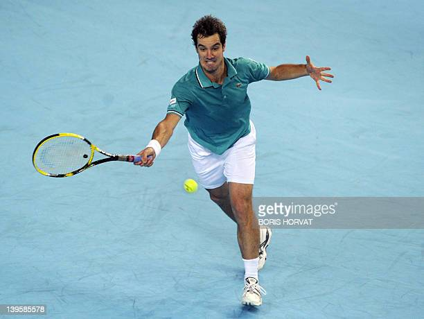 """French Richard Gasquet hits a return to Russian Igor Kunitsyn on February 23 in the southern city of Marseille, during the """"Open 13"""" tennis..."""
