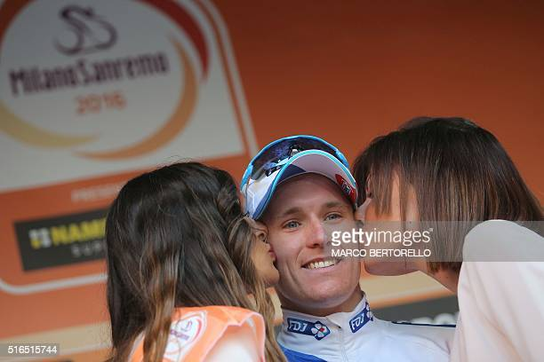 French rider Arnaud Demare celebrates on the podium after he won the 107th edition of the Milan San Remo cycling race on March 19 2016 in San Remo...