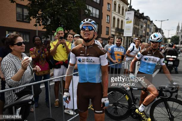 French rider Benoit Cosnefroy reacts after a fall in the first stage of the 106th edition of the Tour de France cycling race between Brussels and...