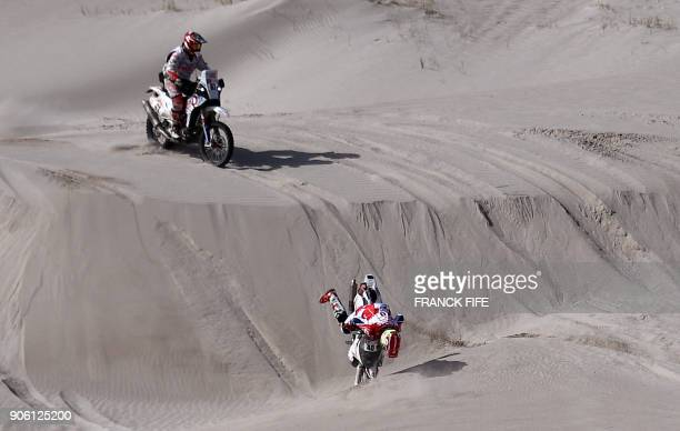 TOPSHOT French rider Johnny Aubert falls in front of Spanish biker Oriol Mena during the Stage 11 of the 2018 Dakar Rally between Belen and Chilecito...