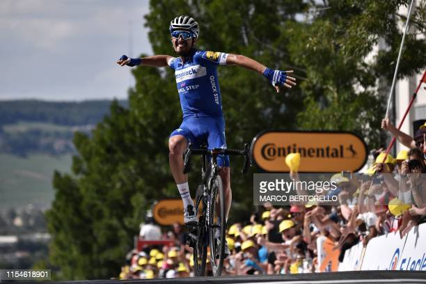 TOPSHOT French rider Julian Alaphilippe celebrates his victory as he crosses the finish line of the third stage of the 106th edition of the Tour de...