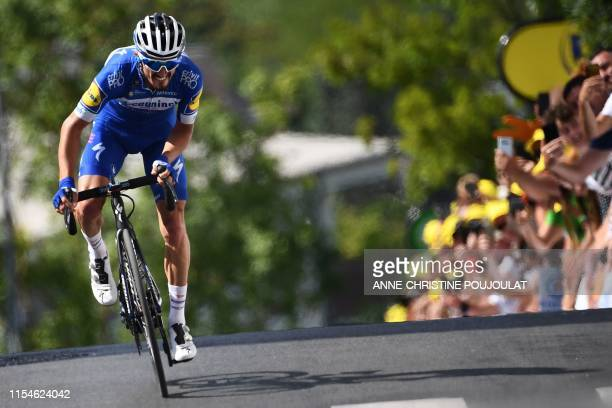 French rider Julian Alaphilippe makes a last effort to win the third stage of the 106th edition of the Tour de France cycling race between Binche and...