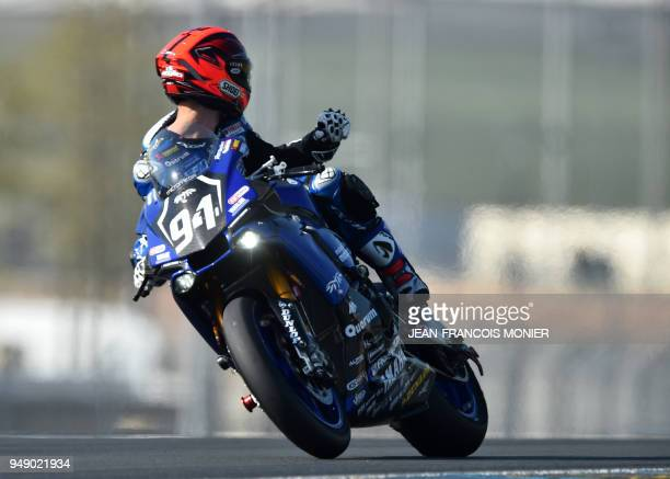TOPSHOT French rider Mike di Meglio on his Yamaha GMT Formula EWC N°94 competes and gestures during a qualifying practice session in Le Mans...