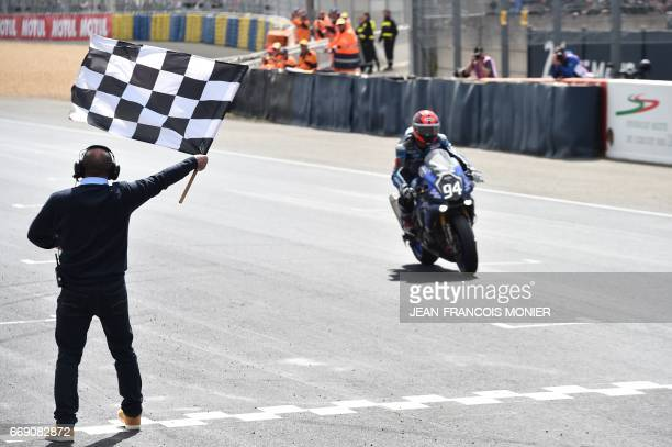 French rider Mike Di Meglio on Yamaha R1 Formula EWC N° 94 crosses the finish line to win the 40th 24hour Le Mans motorcycle endurance race in Le...