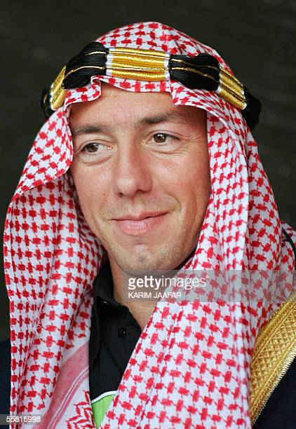 French rider Olivier Jacques wears a traditional Qatari headgear during a visit to a cultural tent at the Losail International Racetrack in Doha 28...