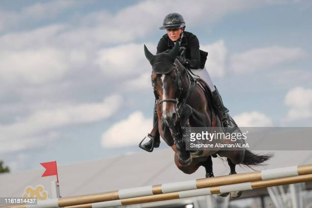 French rider Penelope Leprevost competes in the Grand Prix of Chantilly during the Longines Global Champions Tour, at Hippodrome de Chantilly on July...