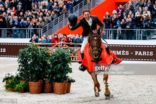 TOPSHOT French rider Simon Delestre celebrates on his horse Ryan des Hayettes Hermes after winning the 'Grand Prix Hermes' International Jumping...