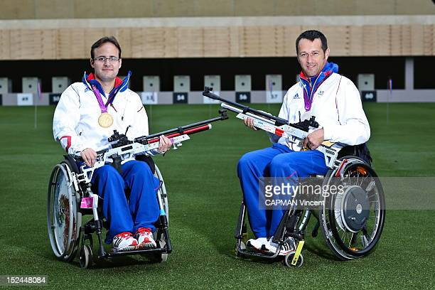 French rifle shooters Cedric Fevre Chevalier gold in shooting 10 meters set and Raphael Voltz quadriplegic silver medal pose during The London 2012...