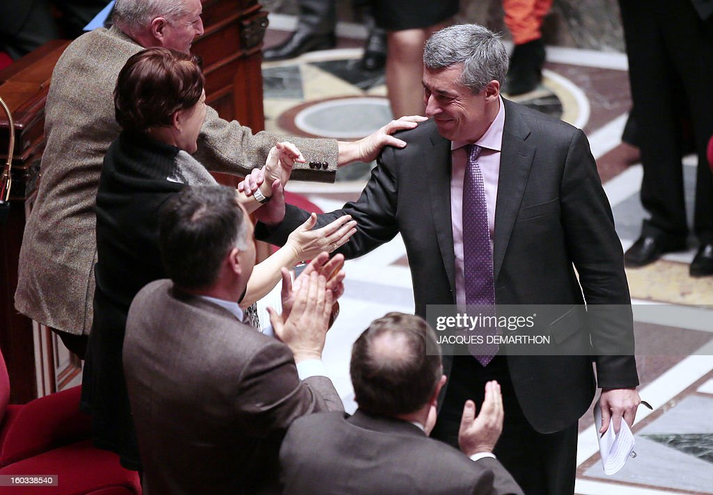 French right wing opposition party (UMP) MP Henri Guaino is congratulated after delivering a speech at the National Assembly on January 29, 2013 in Paris. The French National Assembly is due to begin a marathon debate on legalising same-sex marriage after months of public protests and counter-protests.