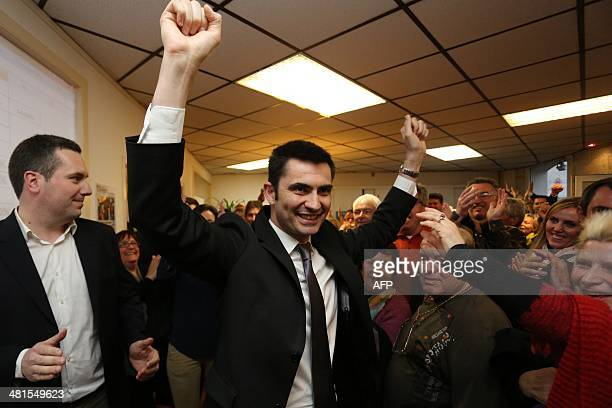 French right wing UMP candidate for the mayoral election in Angouleme Xavier Bonnefont reacts after the announcementof results in the second round of...