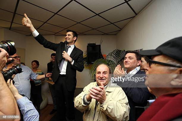 French right wing UMP candidate for the mayoral election in Angouleme Xavier Bonnefont is applauded by supporters after the announcement of results...