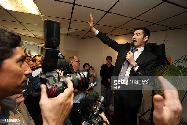 French right wing UMP candidate for the mayoral election in Angouleme Xavier Bonnefont speaks to supporters as he reacts after the announcement of...