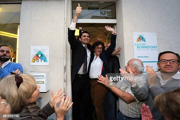 French right wing UMP candidate for the mayoral election in Angouleme Xavier Bonnefont celebrates with supporters after the announcement of results...