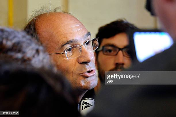 French right wing UMP party MP and former Budget minister Eric Woerth speaks to the journalists at the National Assembly on September 6 in Paris AFP...