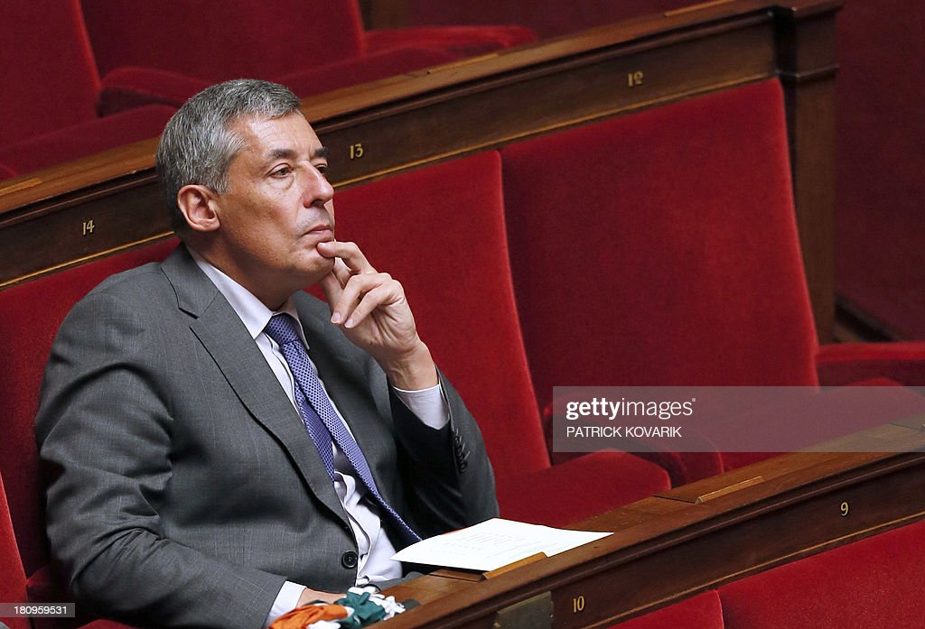 French right wing UMP party MP Henri Guaino listens during a debate at the National Assembly in Paris on a law aimed at putting pressure on companies leaving an industrial site unused to transfer the property and site to another company or the state, on September 18, 2013.