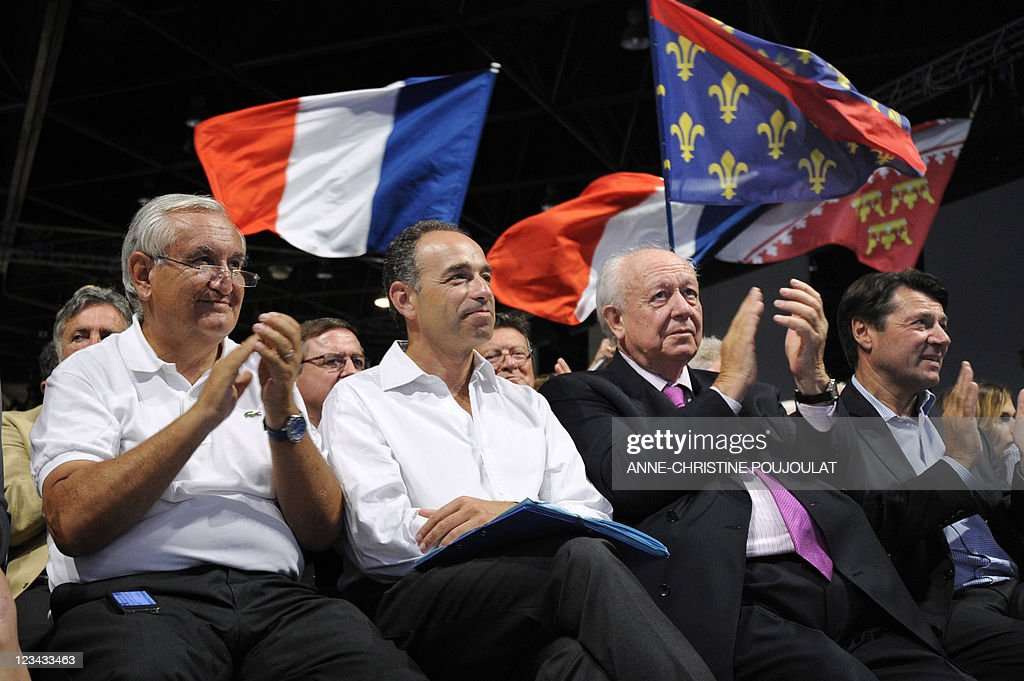 French right wing UMP party vice president national council Jean-Pierre Raffarin (L), flanked by UMP Bas-Rhin senator Fabienne Keller, UMP general secretary Jean-François Copé, UMP Senator Mayor Jean-Claude Gaudin and UMP deputy Christian Estrosi, attend the French right wing UMP party Campus des Jeunes Populaires 2011 (Youth Popular Campus), on September 3, 2011 in Marseille, southern France.