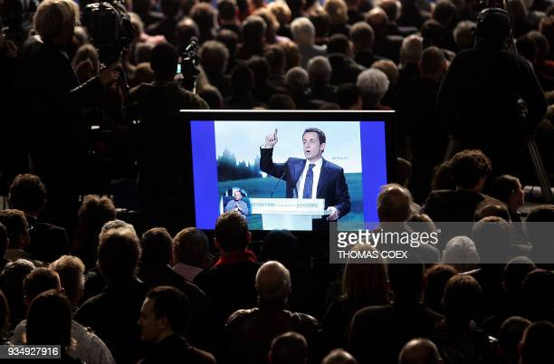 French rightwing candidate for the upcoming 2007 presidential elections Nicolas Sarkozy is seen in a screen as he delivers a speech during a campaign...