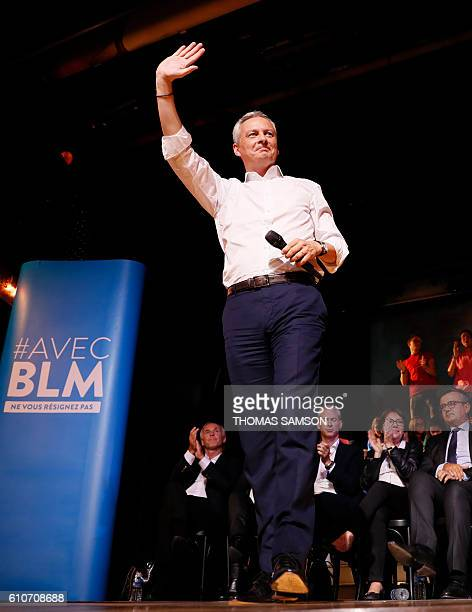 French right-wing Les Republicains candidate for the LR party primaries ahead of the 2017 presidential election, Bruno Le Maire waves to supporters...