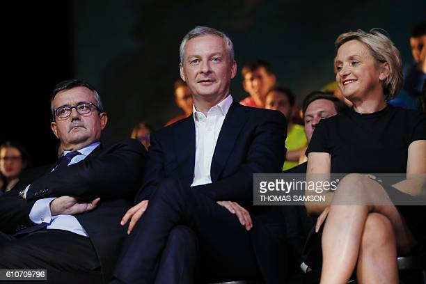 French right-wing Les Republicains candidate for the LR party primaries ahead of the 2017 presidential election, Bruno Le Maire , next to member of...
