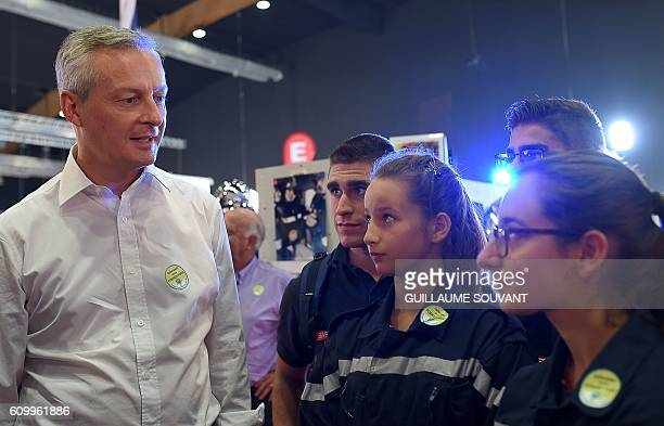 French right-wing Les Republicains party candidate for the party primary ahead of the 2017 presidential election, Bruno Le Maire , speaks with youths...