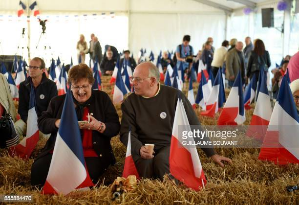 French rightwing Les Republicains party militants attend on September 30 2017 at the Fete de la Violette a political gathering organised by Guillaume...