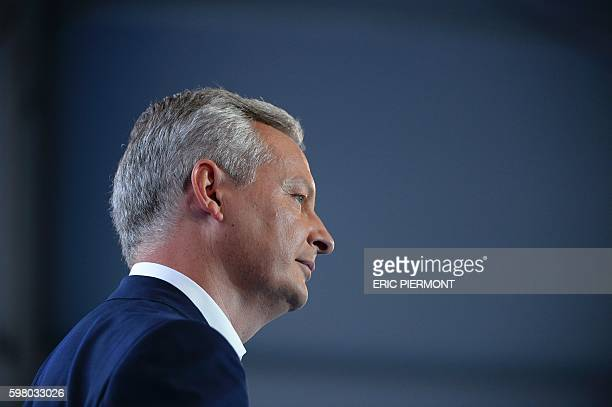 French right-wing Les Republicains party MP and candidate for LR party's primary for the 2017 presidential elections, Bruno Le Maire looks on during...