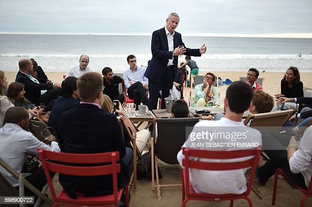 French right-wing Les Republicains party MP and candidate for LR party's primary for the 2017 presidential elections, Bruno Le Maire, toasts with his...
