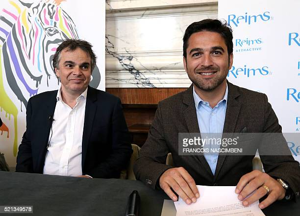 French rightwing Les Republicains party MP and mayor of Reims Arnaud Robinet looks on next to French writer and president of the association Blue...