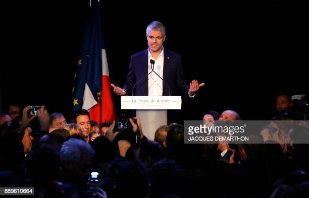 TOPSHOT French rightwing Les Republicains party newlyelected President Laurent Wauquiez reacts after the results' announcement on December 10 2017 at...