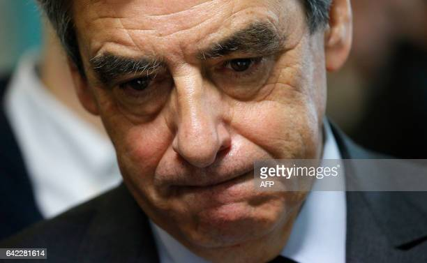 French right-wing Les Republicains party's presidential election candidate, Francois Fillon reacts as he visits a social center in Tourcoing,...