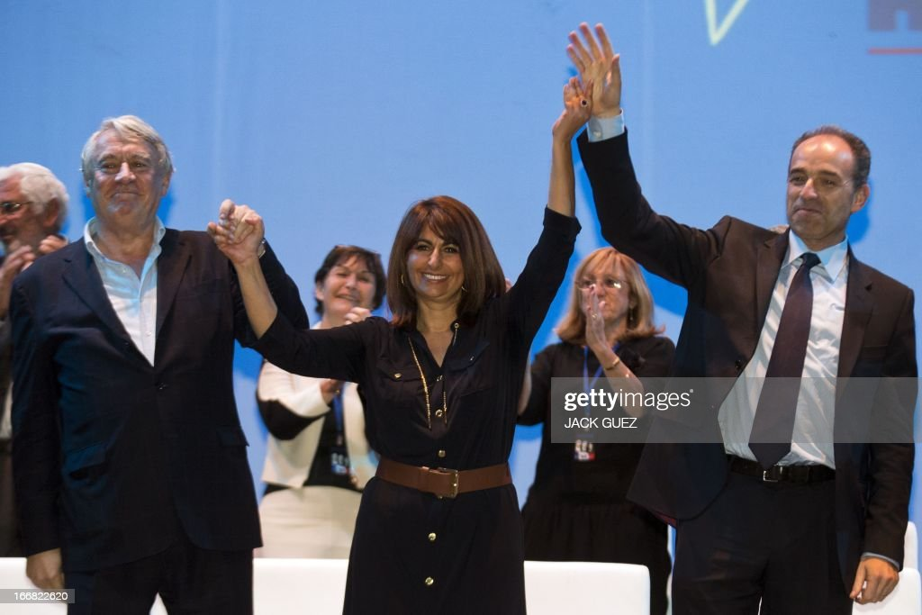 French right-wing opposition party, Union for a Popular Movement (UMP) president Jean-Francois Cope (R) waves at the audience after addressing Israelis holding the French nationality during a campaign meeting to support Valerie Hoffenberg (C) UMP candidate at a local parliamentary election, on April 17, 2013 in the Mediterranean coastal city of Tel Aviv.