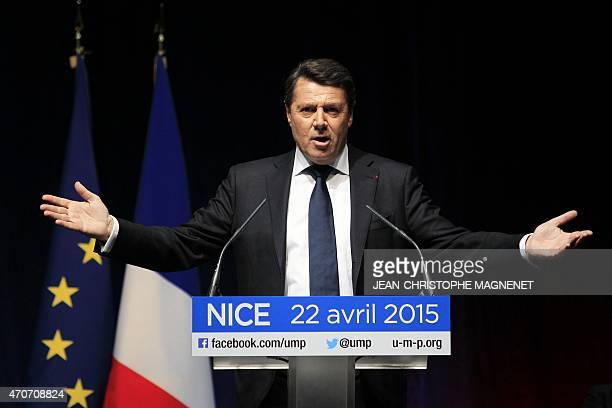 French rightwing opposition UMP mayor of Nice Christian Estrosi gestures as he delivers a speech to introduce to the stage former French president...