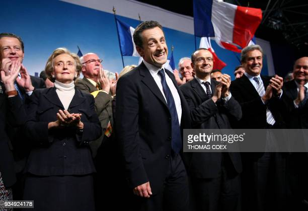 French rightwing party UMP presidential candidate Nicolas Sarkozy gestures next to French First Lady Bernadette Chirac at the end of a campaign...