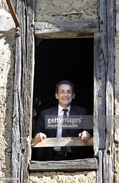 French rightwing presidential candidate Nicolas Sarkozy appears at window of an old house of the 15th century which has been renoved by 'Compagnons'...