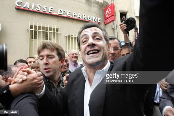 French rightwing presidential candidate Nicolas Sarkozy arrives to deliver a speech in front of the city hall of ChateauneufduPape southeastern...